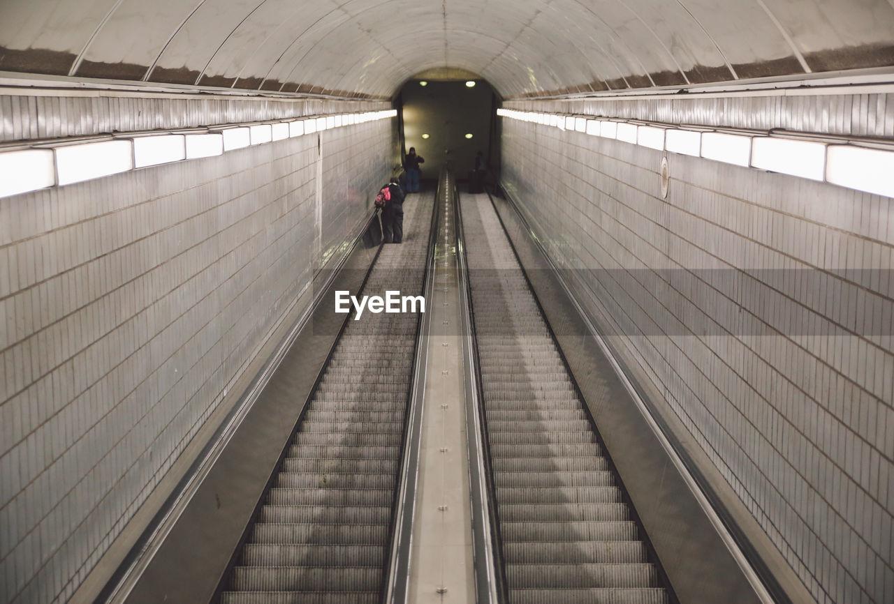 High Angle View Of Illuminated Escalator In Subway Station