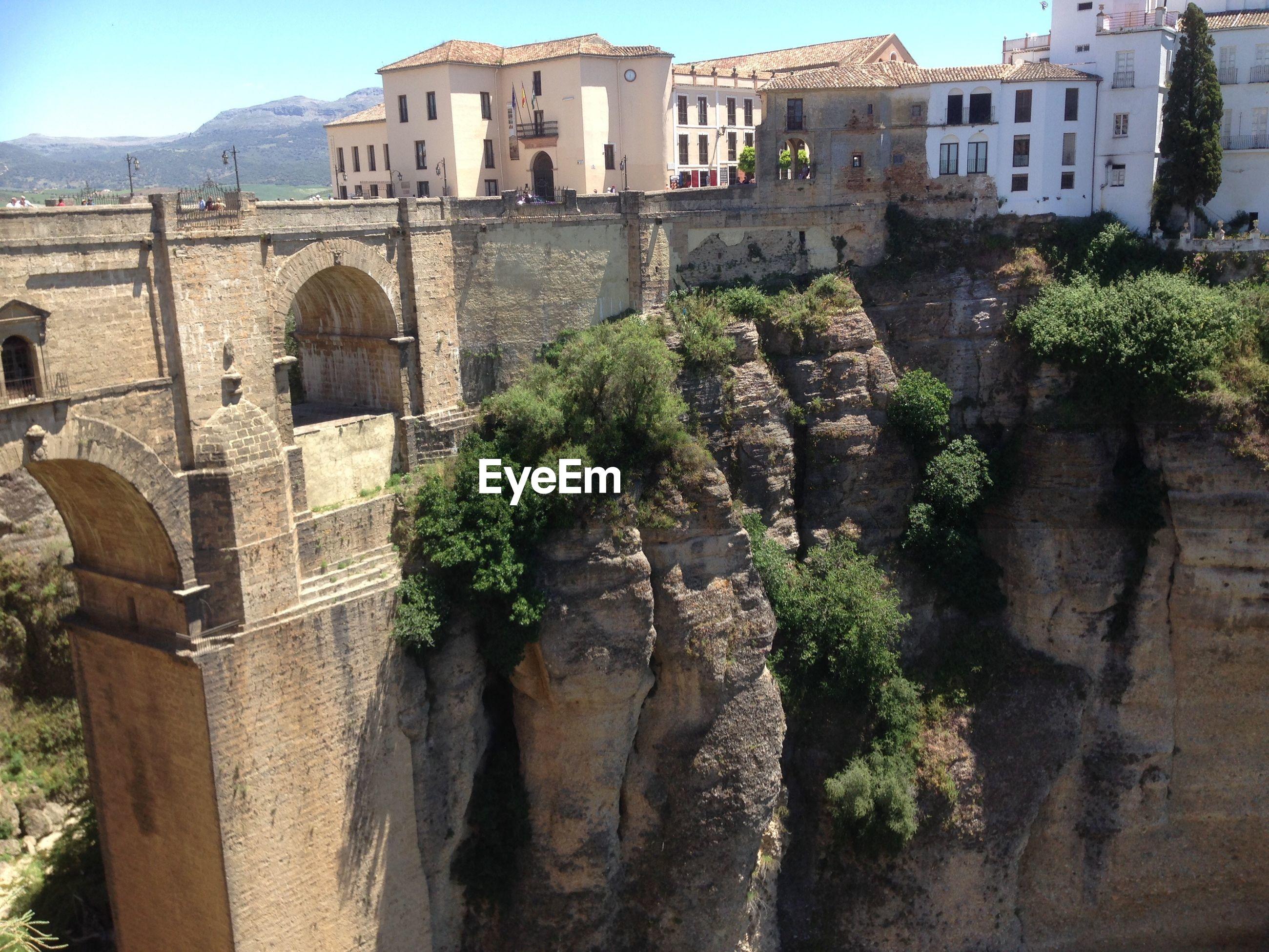 Arch bridge and rock face