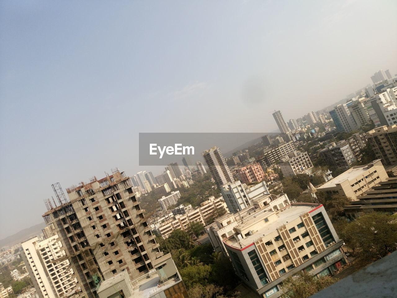 Tilt image of buildings in city