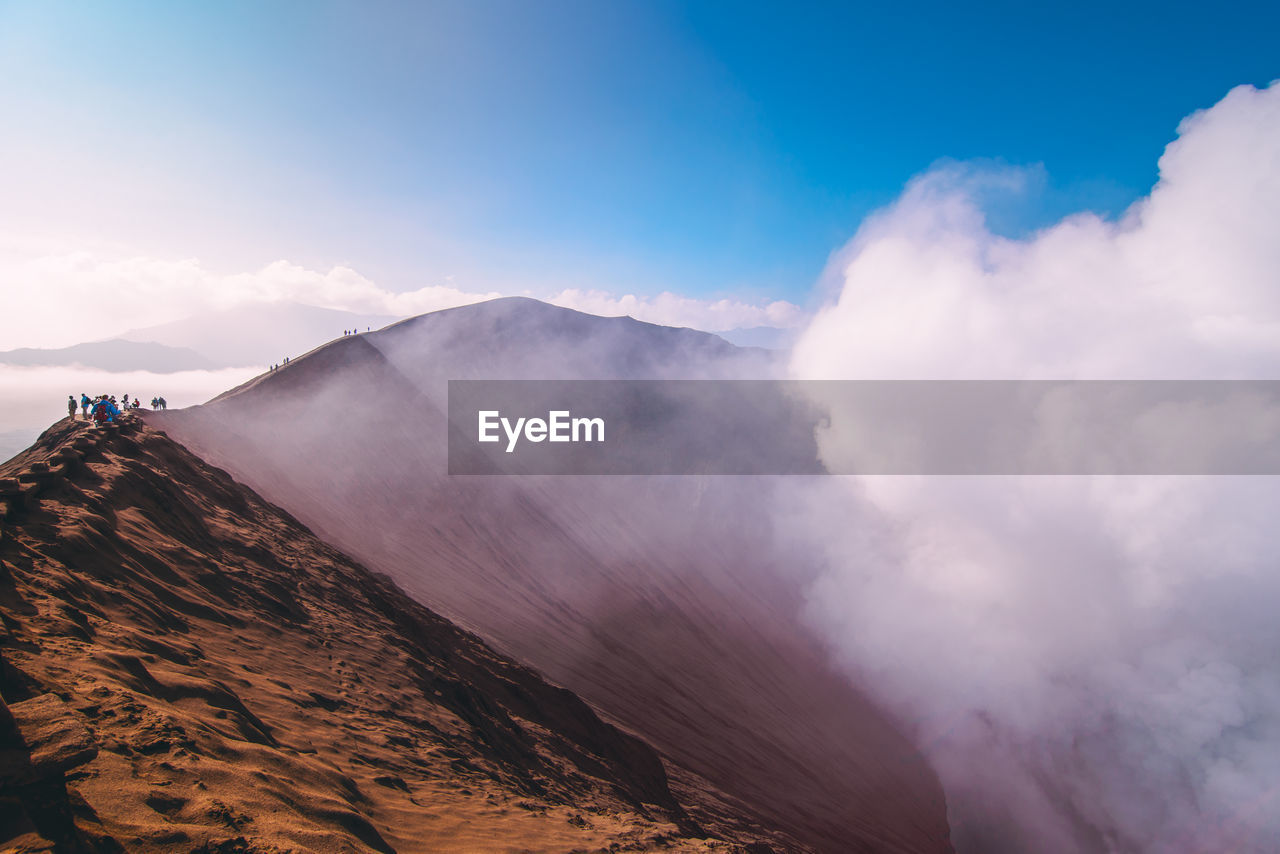 Scenic View Of Mountains Amidst Clouds