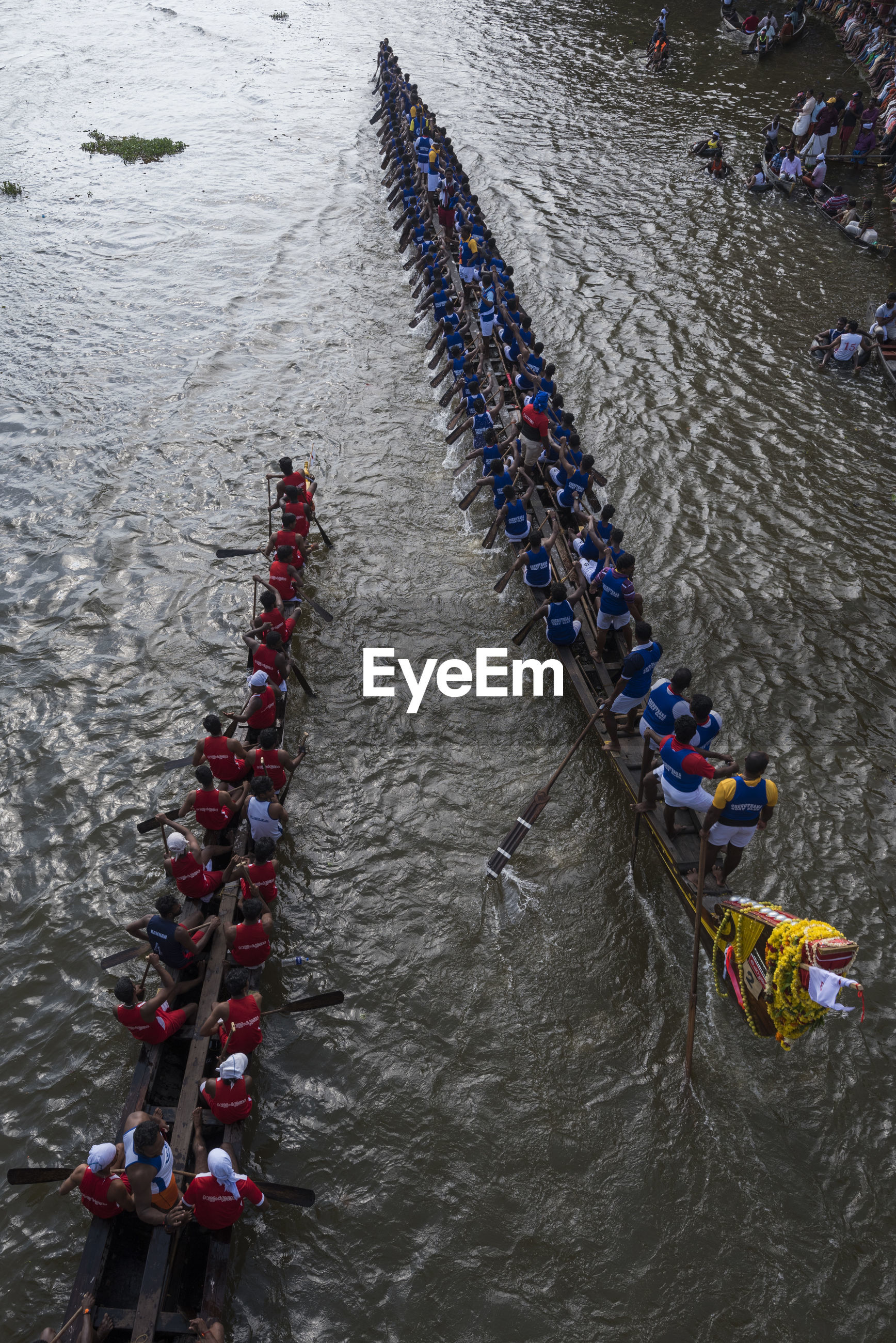 HIGH ANGLE VIEW OF PEOPLE IN BOAT