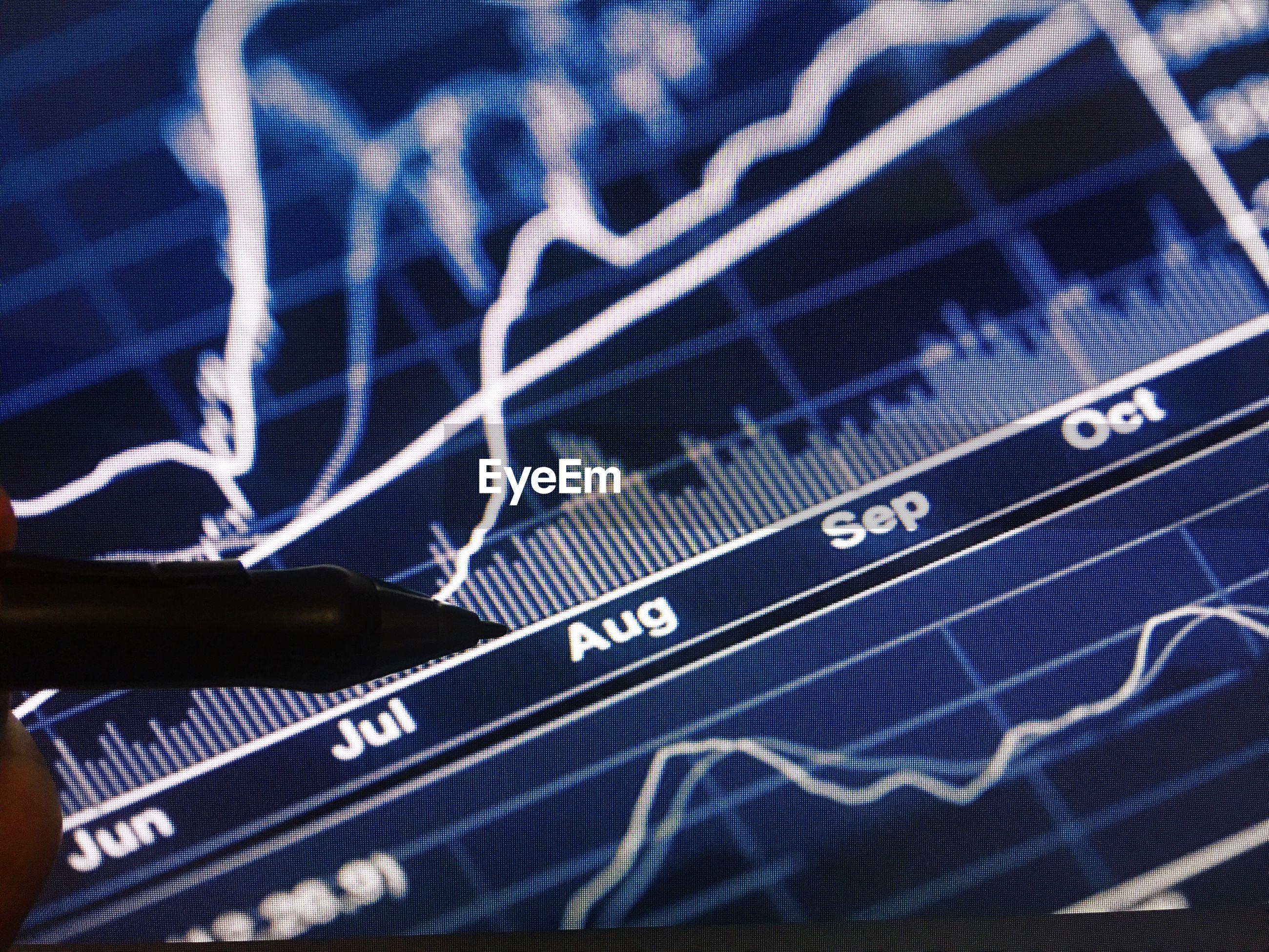 Close-up of stylus on digital display