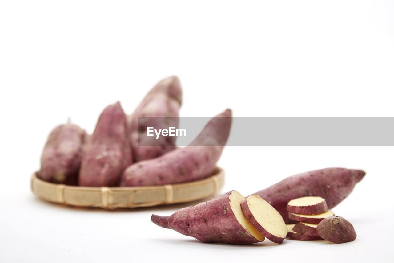 food and drink, food, studio shot, white background, freshness, indoors, still life, healthy eating, close-up, copy space, no people, wellbeing, fruit, slice, focus on foreground, group of objects, raw food, selective focus, brown, table, purple