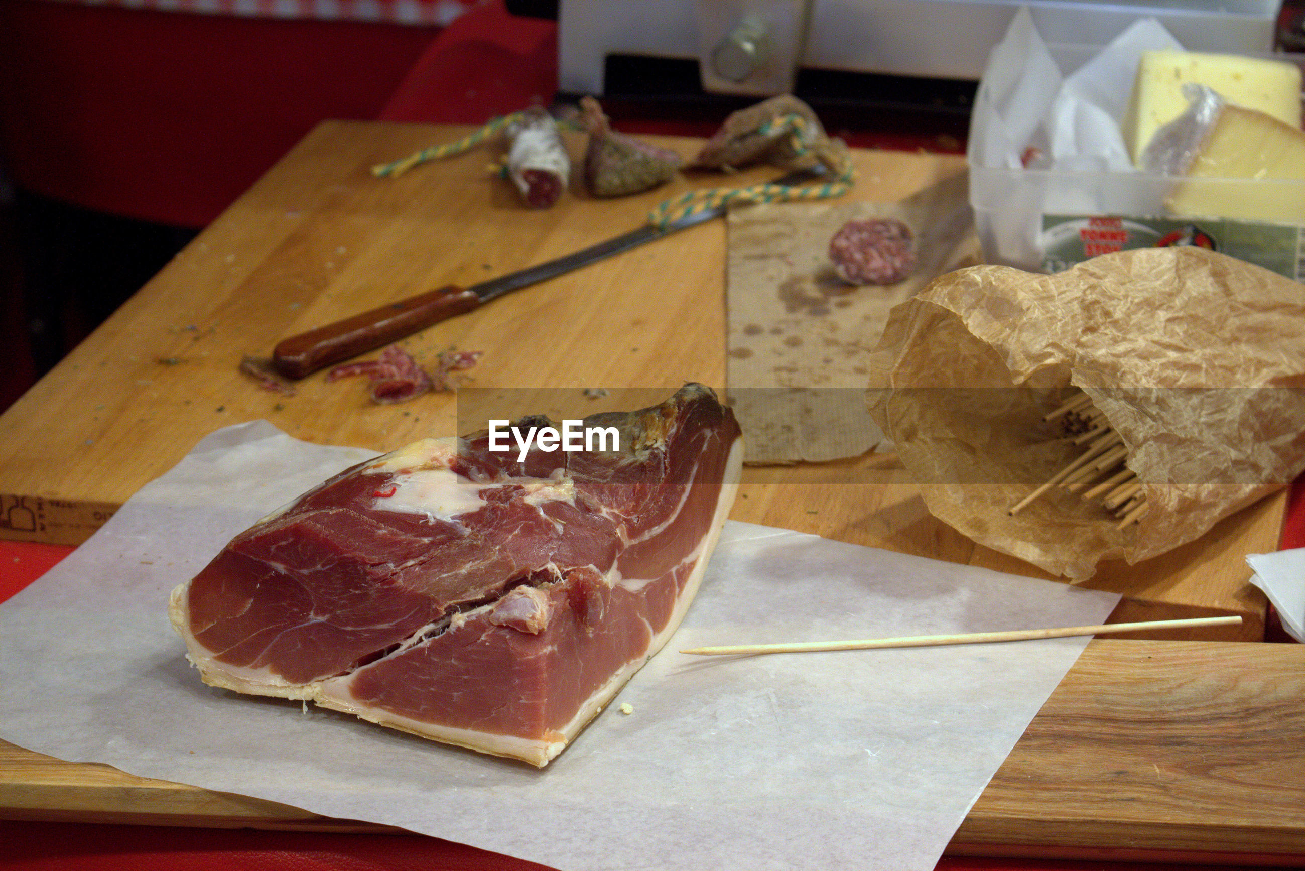 High angle view of meat by knife on wooden table