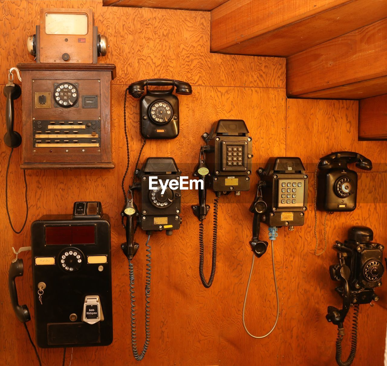 technology, old-fashioned, retro styled, old, indoors, connection, no people, wood - material, camera - photographic equipment, variation, antique, communication, photography themes, telephone, close-up, industry, rotary phone, movie camera, man made, day