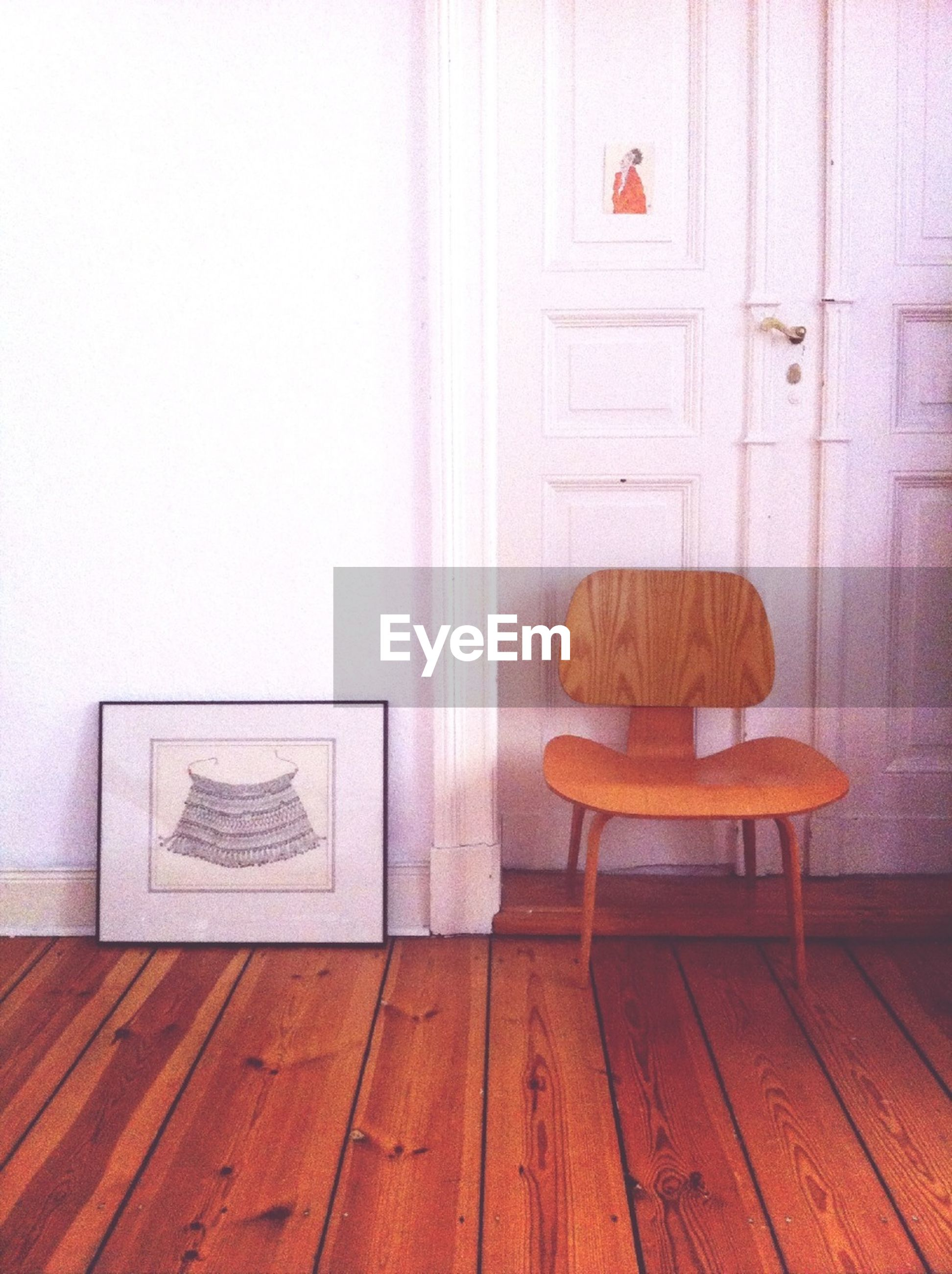 indoors, table, wood - material, still life, home interior, chair, wall - building feature, wooden, absence, empty, hardwood floor, furniture, domestic room, wall, wood, no people, door, red, brown, simplicity