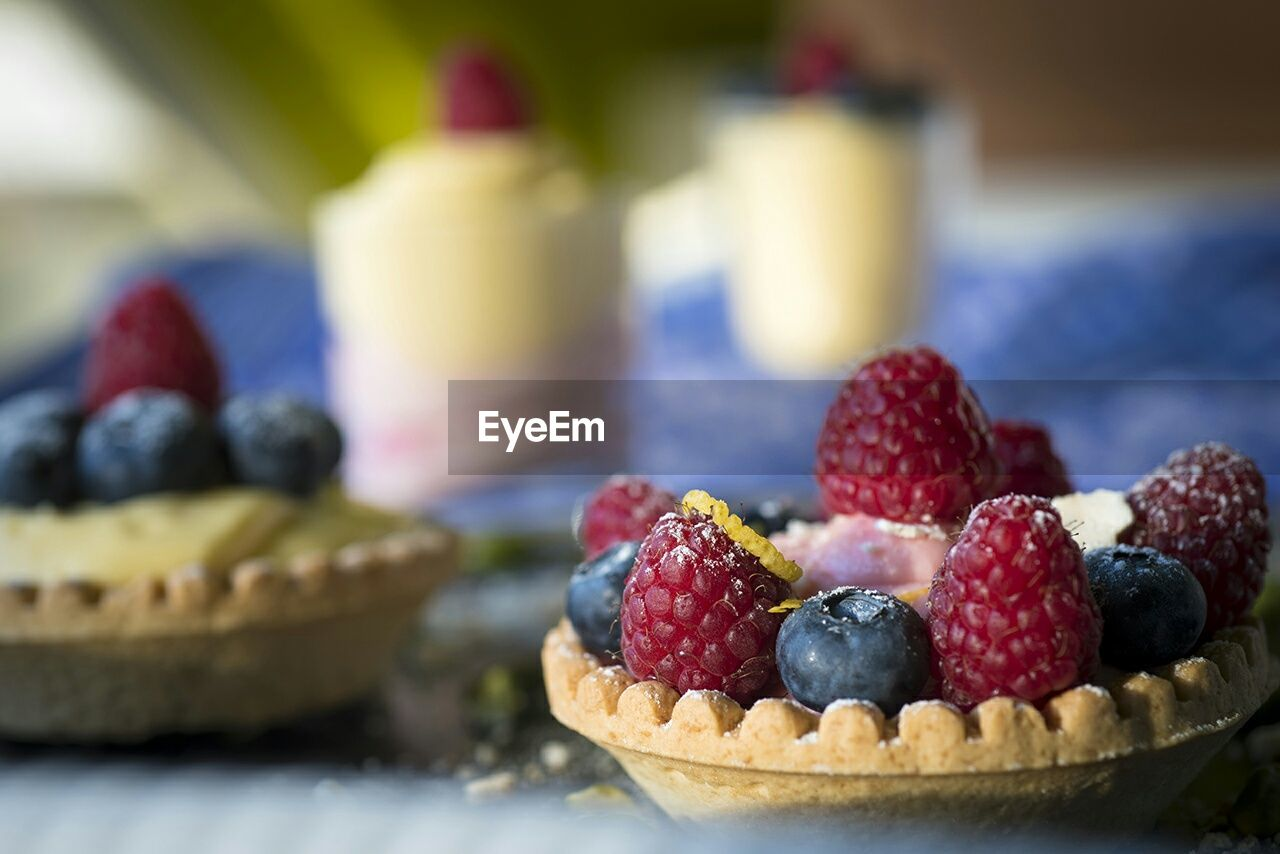 Close-Up Of Fruit Tarts On Table