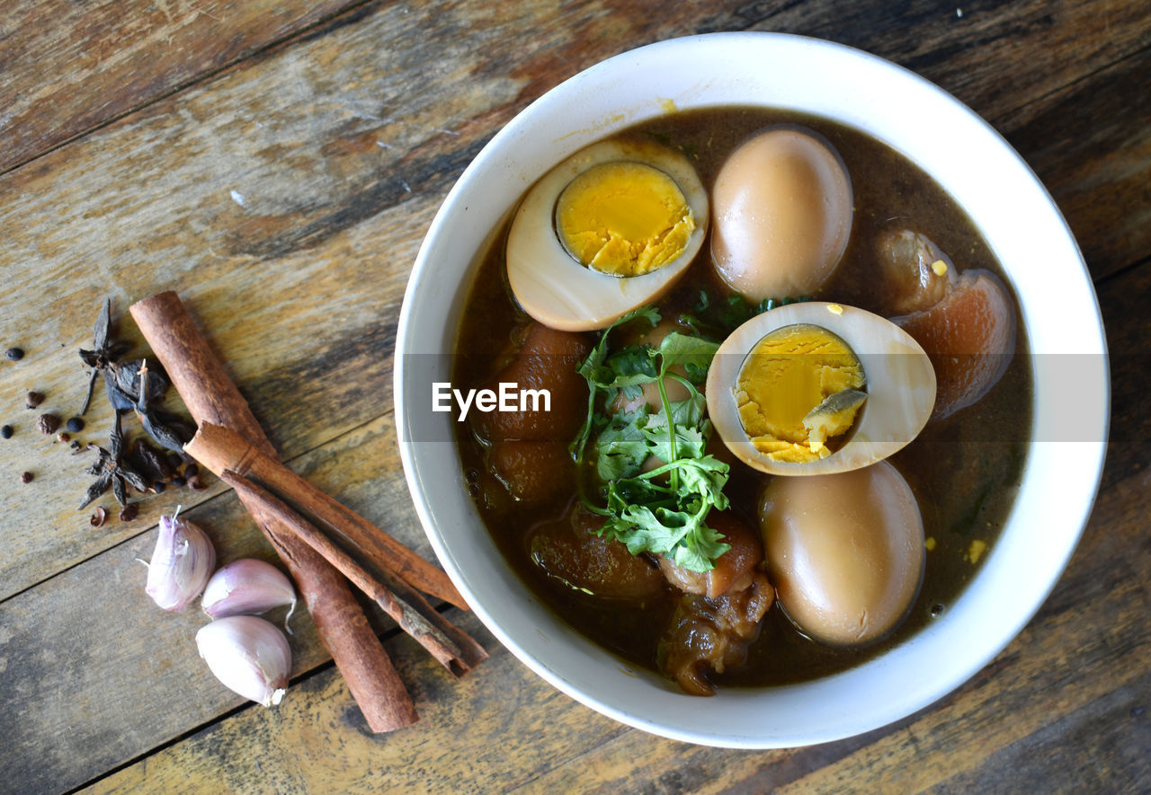 food, egg, food and drink, healthy eating, freshness, bowl, table, wellbeing, ready-to-eat, indoors, wood - material, directly above, high angle view, no people, kitchen utensil, egg yolk, boiled egg, still life, boiled, vegetable, noodle soup, japanese food