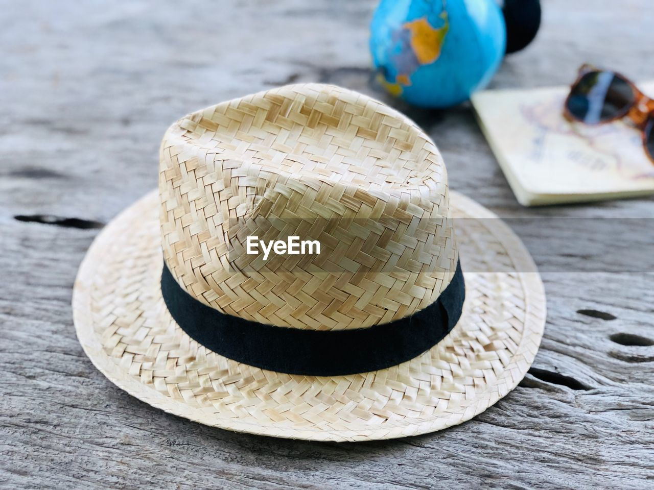 wood - material, table, hat, still life, close-up, focus on foreground, no people, day, outdoors, nature, variation, sunlight, choice, clothing, group of objects, straw hat, group, food and drink, textured, selective focus