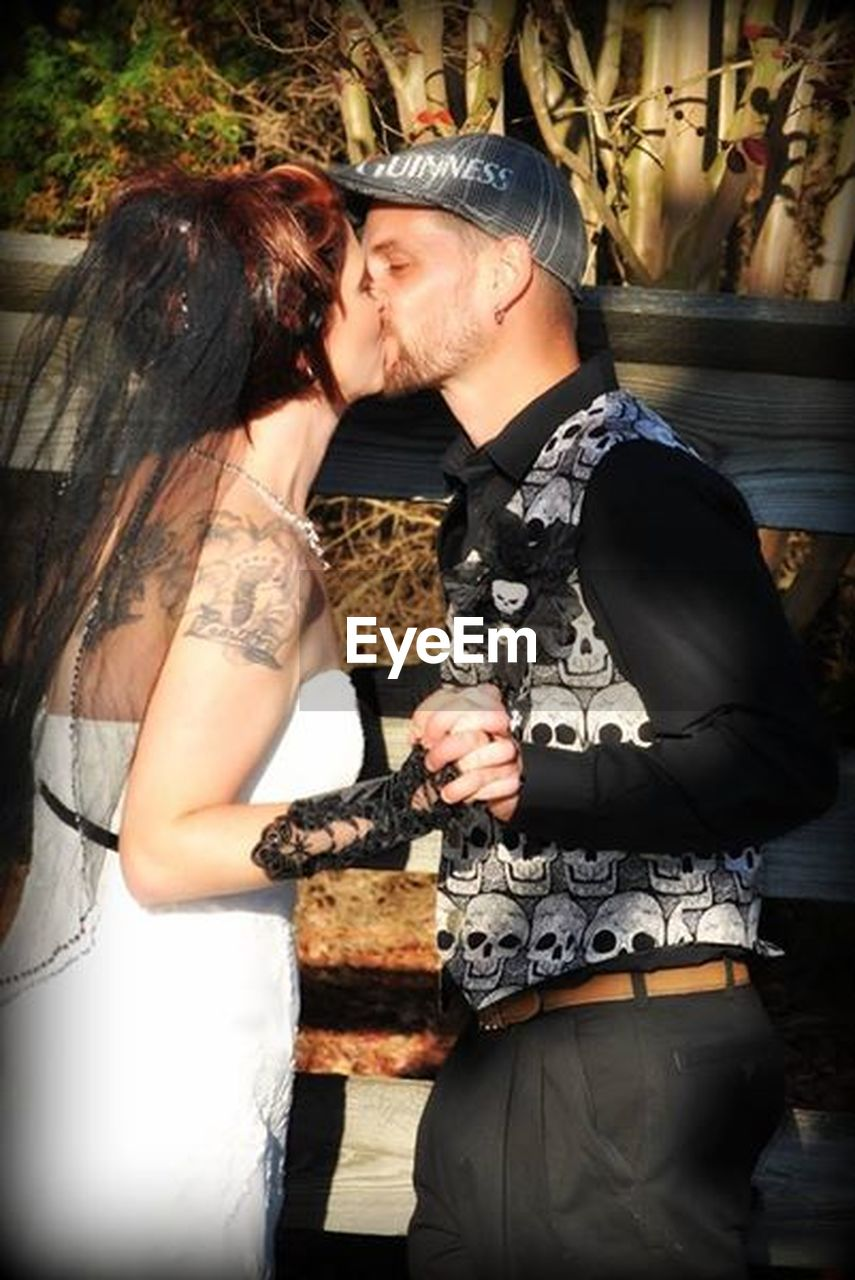 love, men, heterosexual couple, two people, embracing, adults only, adult, togetherness, couple - relationship, people, standing, beautiful people, young men, passion, young adult, women, well-dressed, young women, outdoors, beautiful woman, bridegroom, evening gown, day
