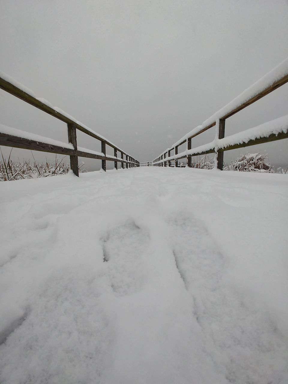 bridge - man made structure, snow, winter, cold temperature, connection, weather, railing, built structure, nature, outdoors, day, no people, architecture, clear sky, sky, beauty in nature
