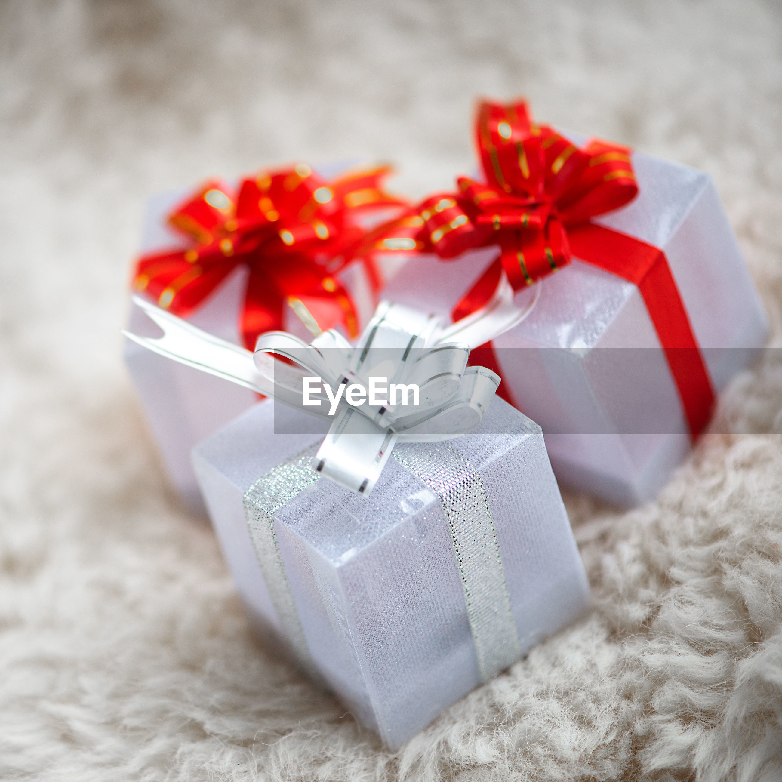 Close-up of three gift  boxs with red ribbon isolated on white, christmas background, copy space