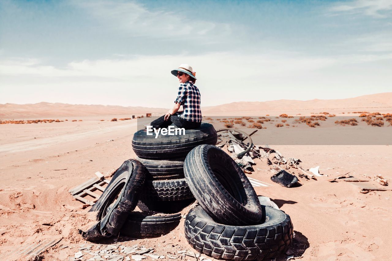 sand, day, outdoors, real people, desert, one person, standing, adventure, full length, arid climate, sky, nature, people