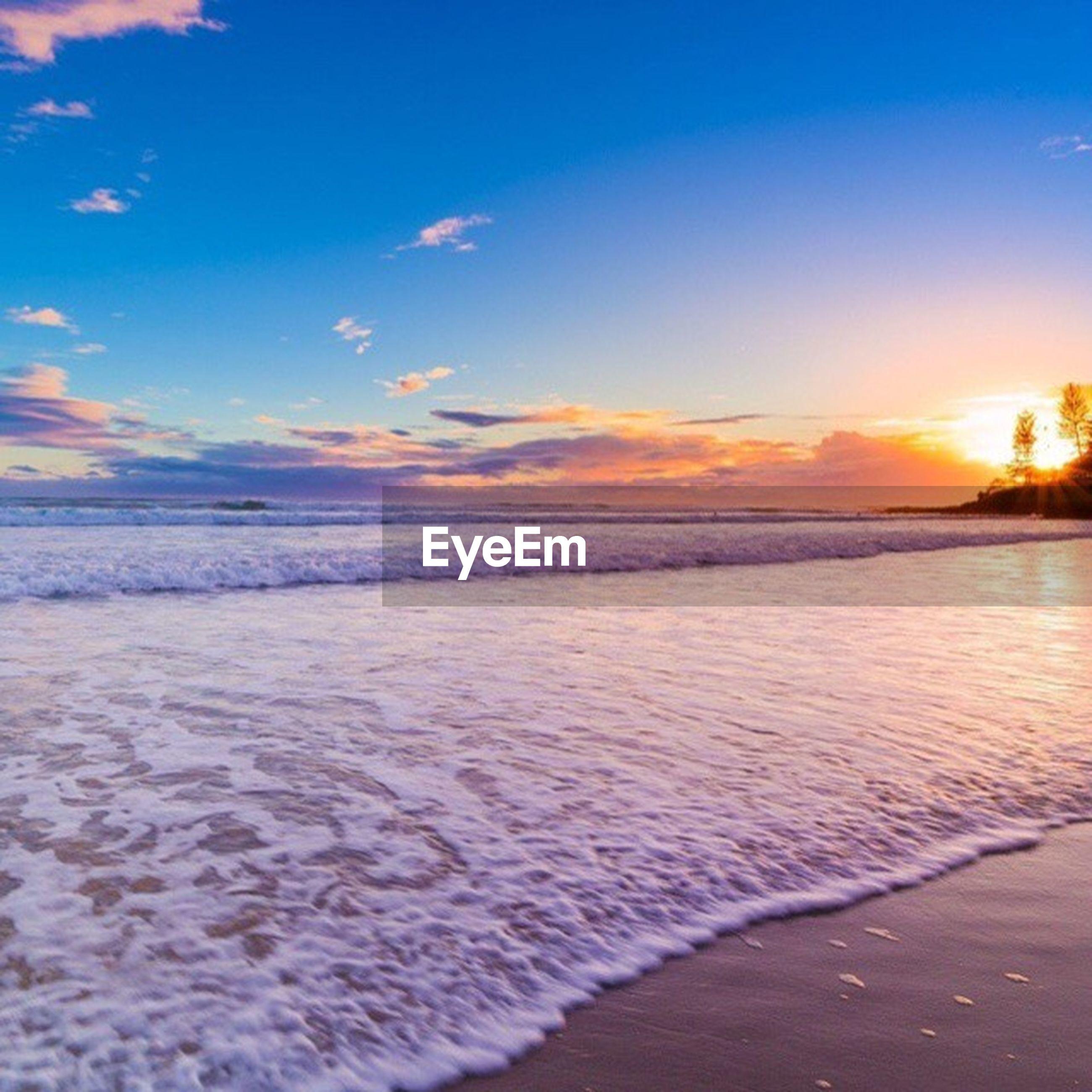 sunset, tranquil scene, scenics, tranquility, cold temperature, snow, water, winter, sky, beauty in nature, nature, beach, sea, idyllic, cloud - sky, season, shore, orange color, frozen, weather
