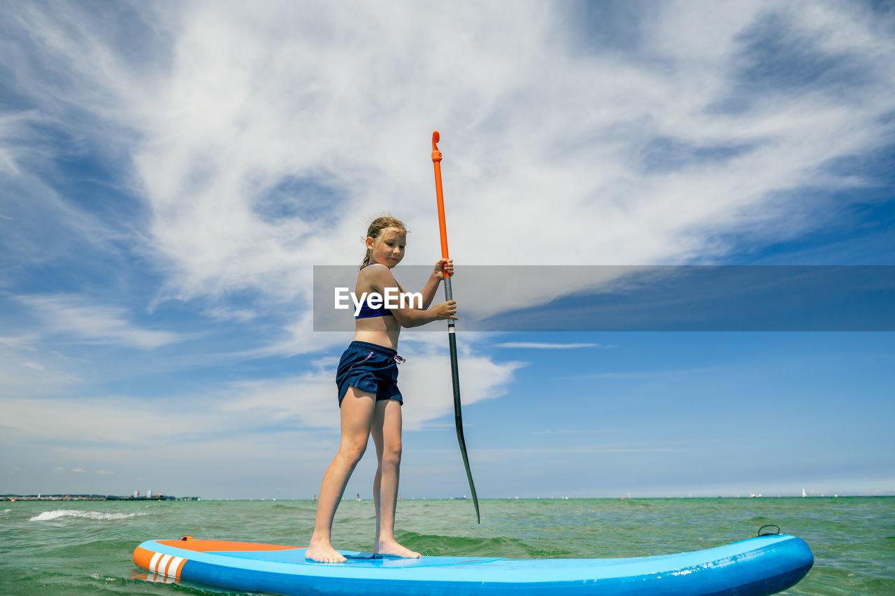 Full length of woman on sea against sky