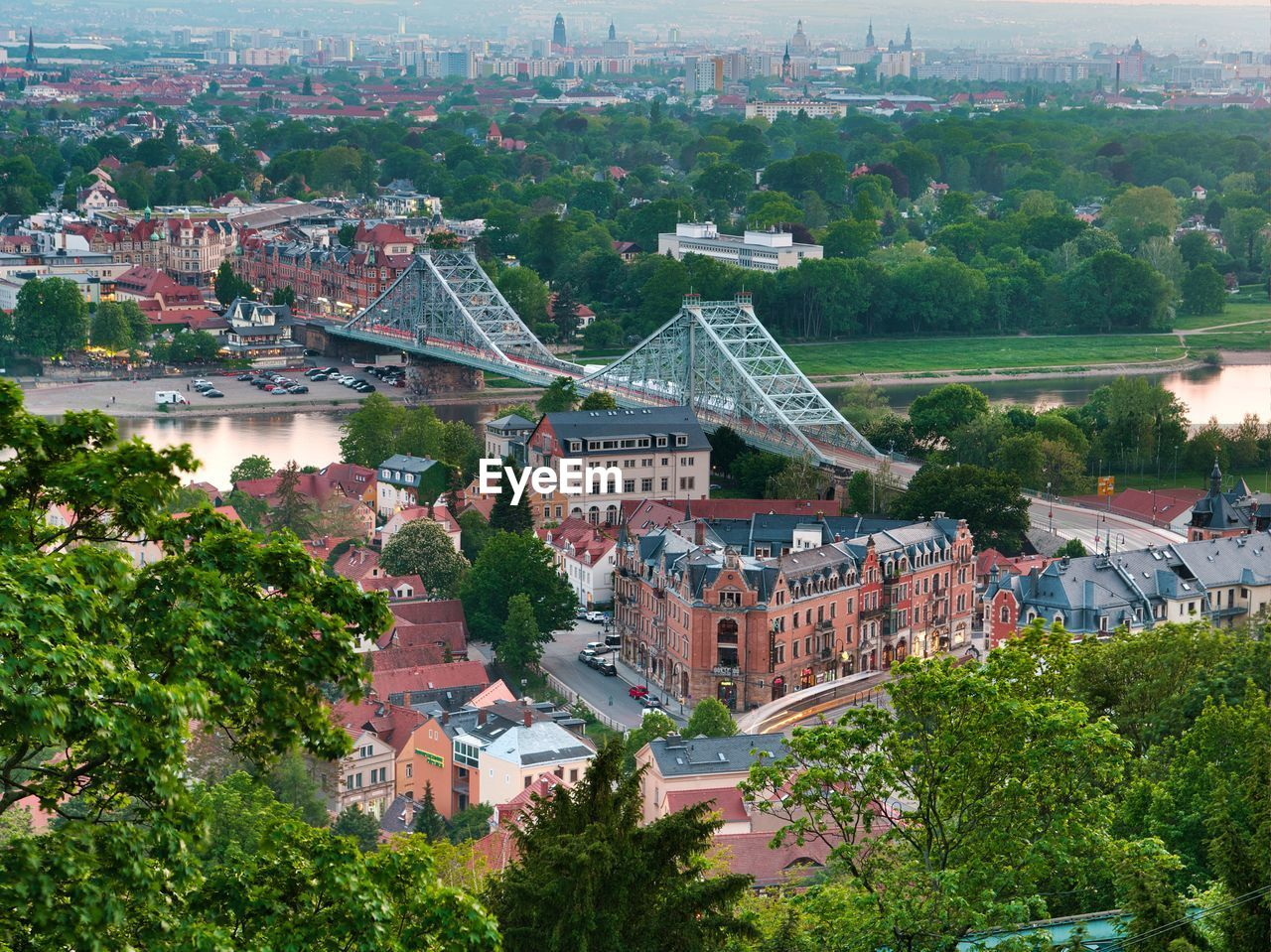 architecture, built structure, building exterior, city, tree, plant, building, cityscape, high angle view, nature, residential district, day, river, crowded, water, town, outdoors, townscape