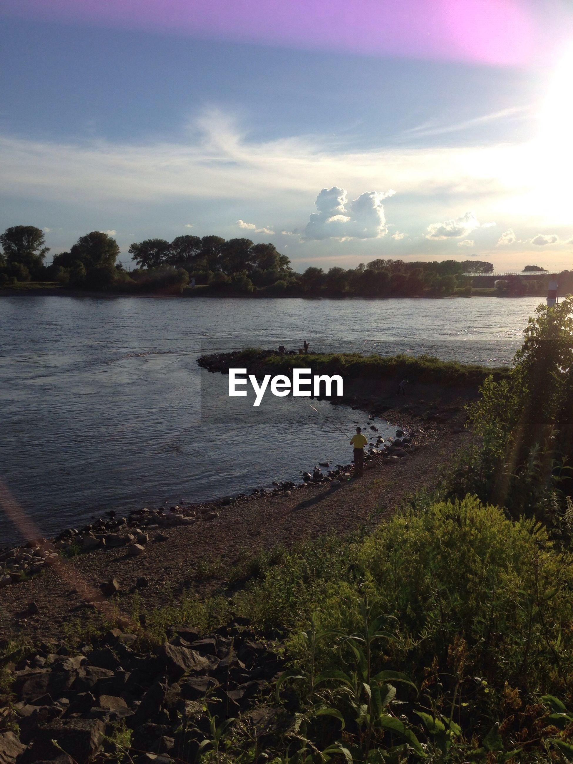 Scenic view of river against during sunset