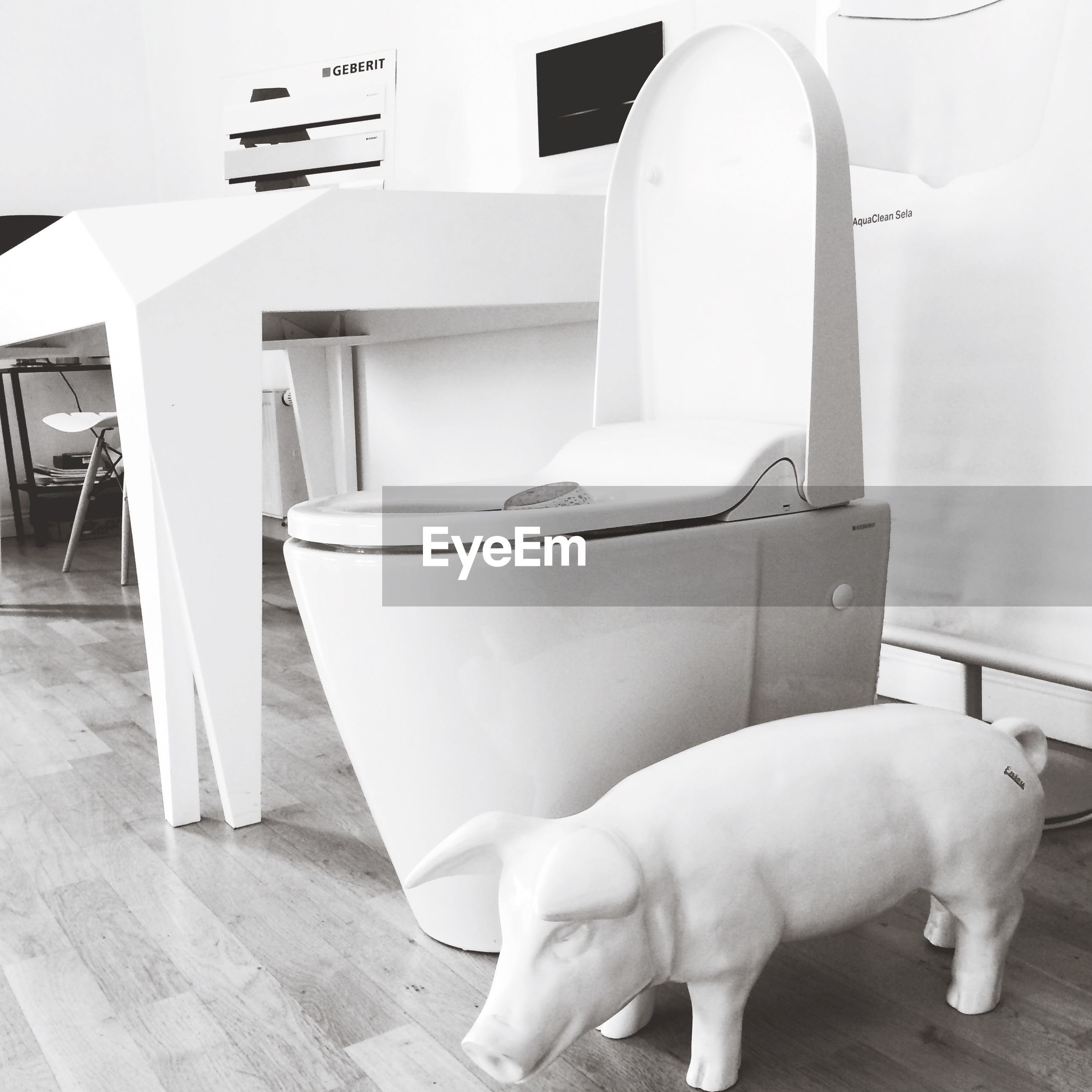 indoors, animal themes, one animal, white color, domestic animals, mammal, pets, animal representation, part of, human representation, architecture, day, art and craft, built structure, no people, relaxation, white, close-up, chair, art