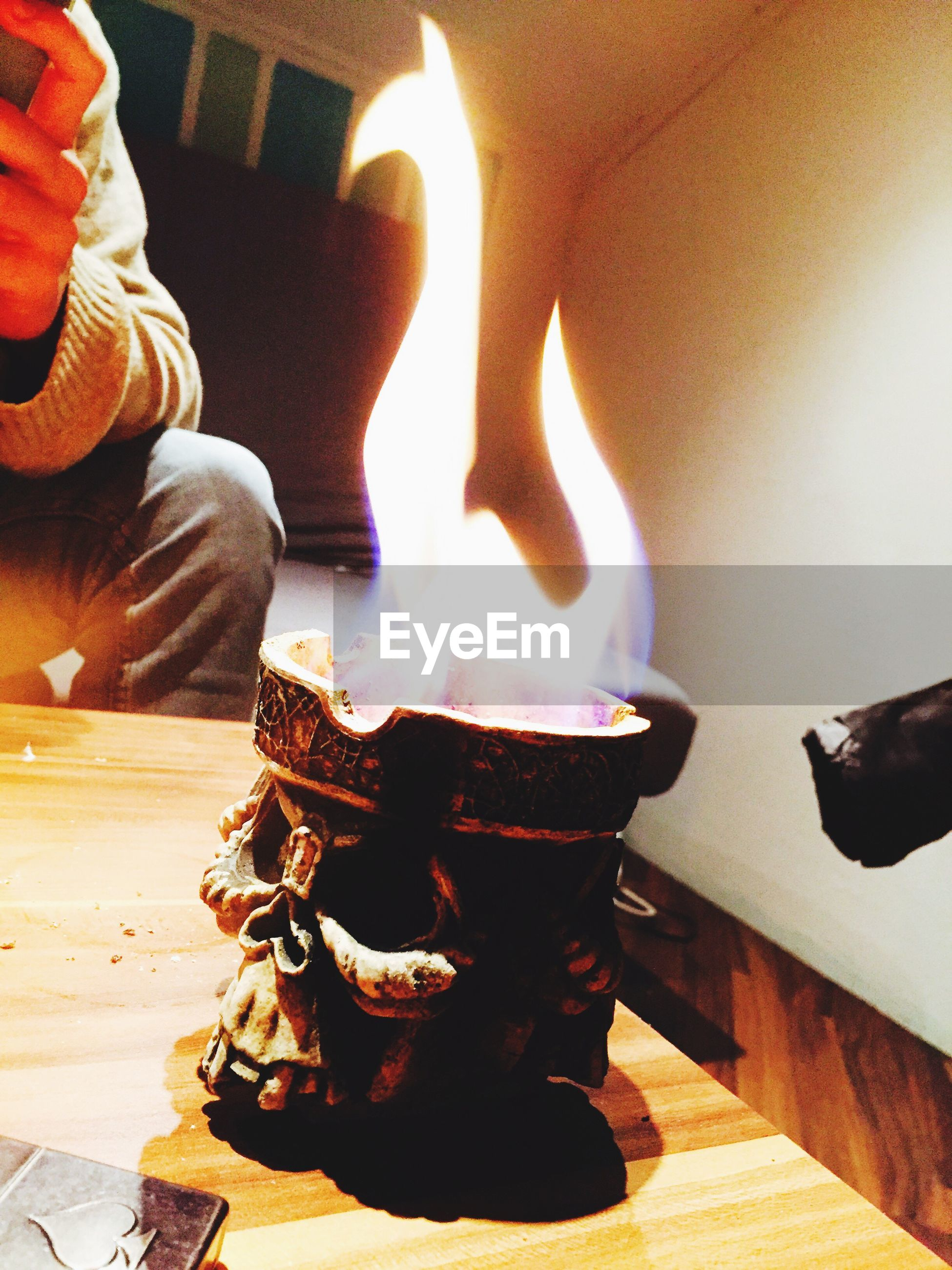 flame, burning, heat - temperature, indoors, fire - natural phenomenon, illuminated, wood - material, glowing, night, candle, sunlight, men, fire, sitting, table, close-up, focus on foreground, sunbeam