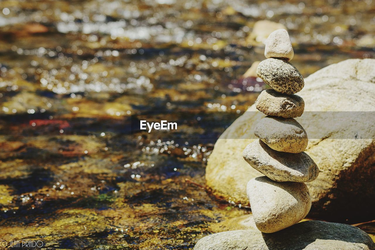 solid, rock, balance, stack, rock - object, zen-like, stone - object, nature, focus on foreground, no people, water, stone, day, close-up, textured, outdoors, pebble, beach, land, flowing water