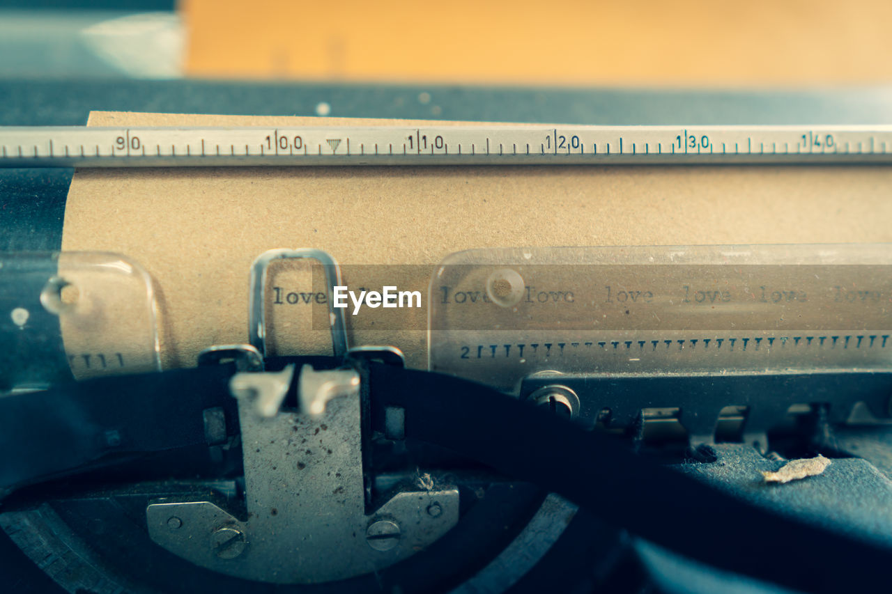 close-up, no people, technology, retro styled, typewriter, typescript, communication, metal, old, number, text, indoors, obsolete, connection, antique, analog, equipment, paper, selective focus