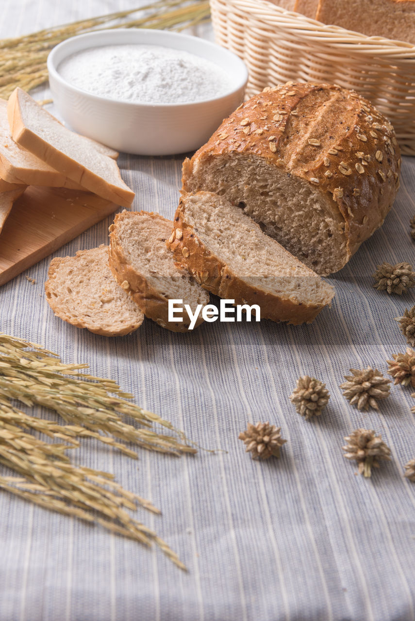 bread, food, whole wheat, food and drink, wheat, wholegrain, healthy eating, loaf of bread, table, cereal plant, breakfast, freshness, no people, brown bread, indoors, close-up, day