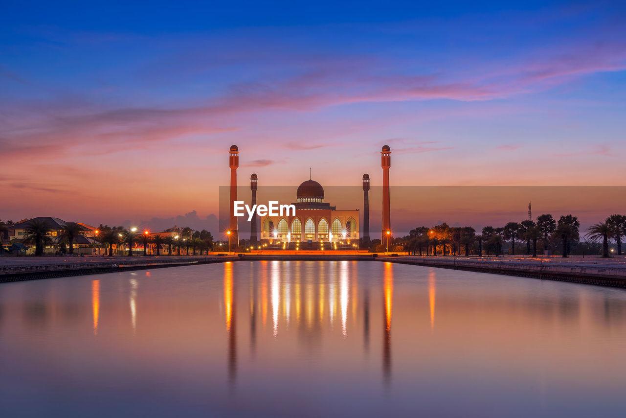 Illuminated masjid songkhla against sky during sunset