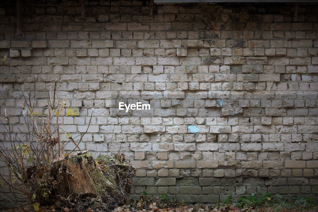 STONE WALL OF OLD BRICK BUILDING
