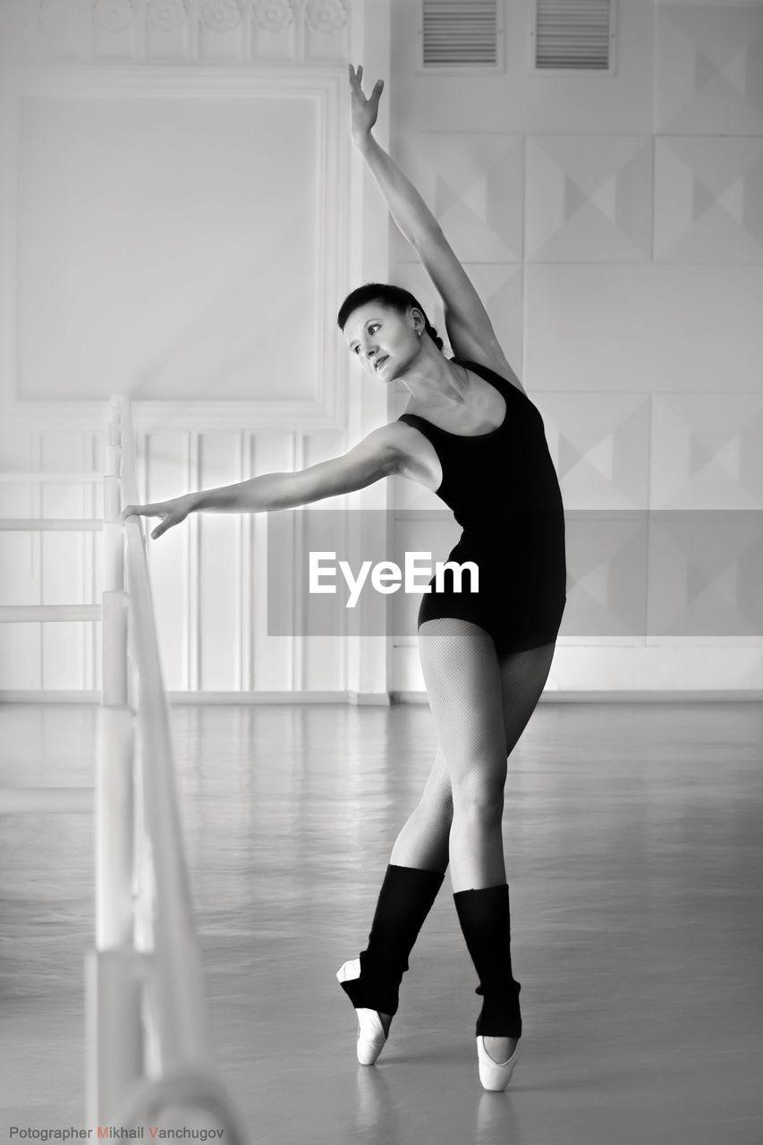 Portrait Of Woman Dancing In Studio