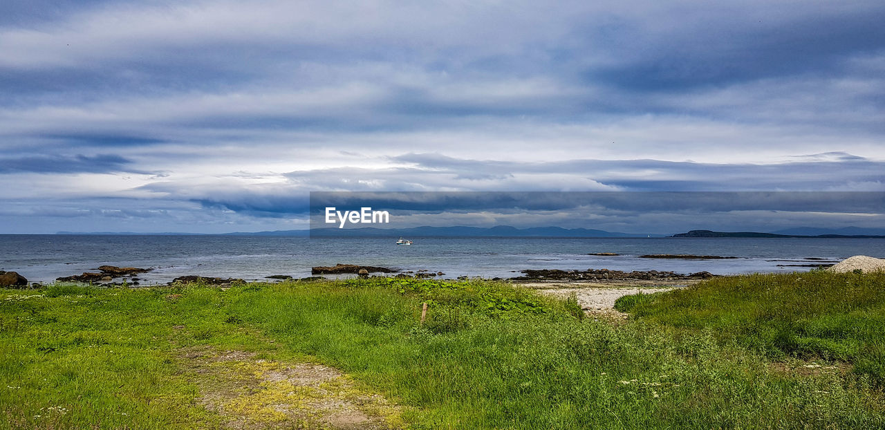 cloud - sky, grass, water, beauty in nature, scenics - nature, plant, sky, tranquil scene, tranquility, land, sea, nature, green color, day, no people, growth, non-urban scene, beach, outdoors