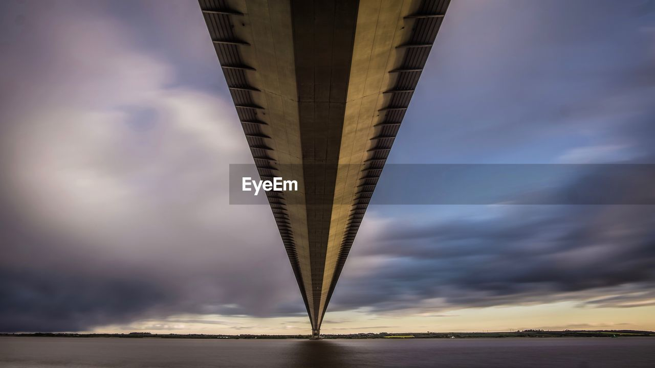 sky, cloud - sky, sunset, architecture, no people, built structure, nature, low angle view, bridge - man made structure, bridge, connection, outdoors, transportation, sunlight, tall - high, dusk, travel destinations, beauty in nature, scenics - nature