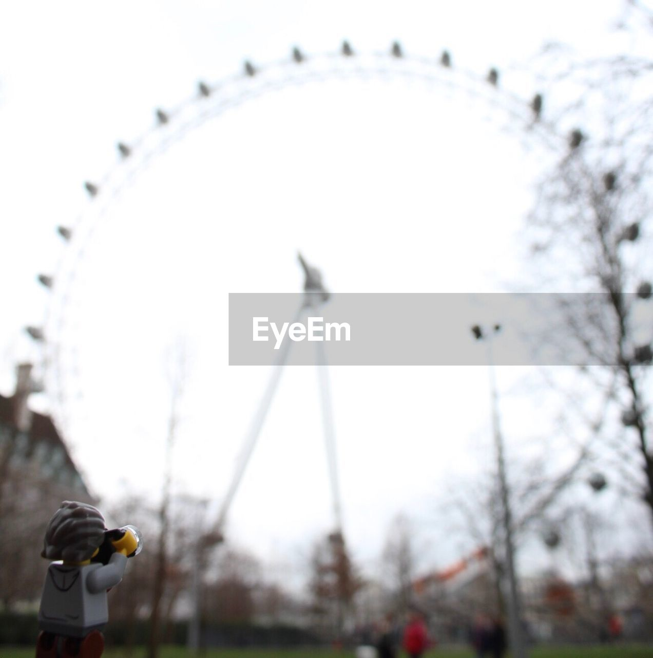 ferris wheel, no people, focus on foreground, sky, close-up, day, outdoors, city, hour hand, clock