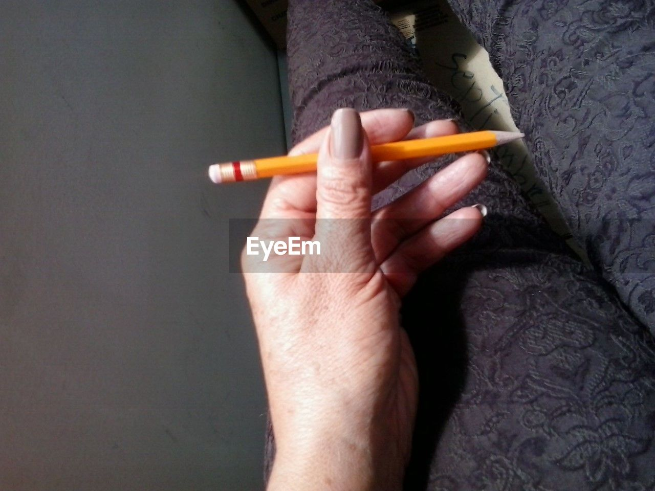 holding, human hand, hand, human body part, cigarette, one person, close-up, smoking issues, indoors, bad habit, real people, activity, warning sign, sign, smoking - activity, social issues, risk, cigarette butt