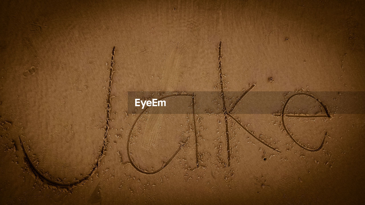 text, handwriting, sand, communication, single word, no people, beach, close-up, nature, outdoors, day