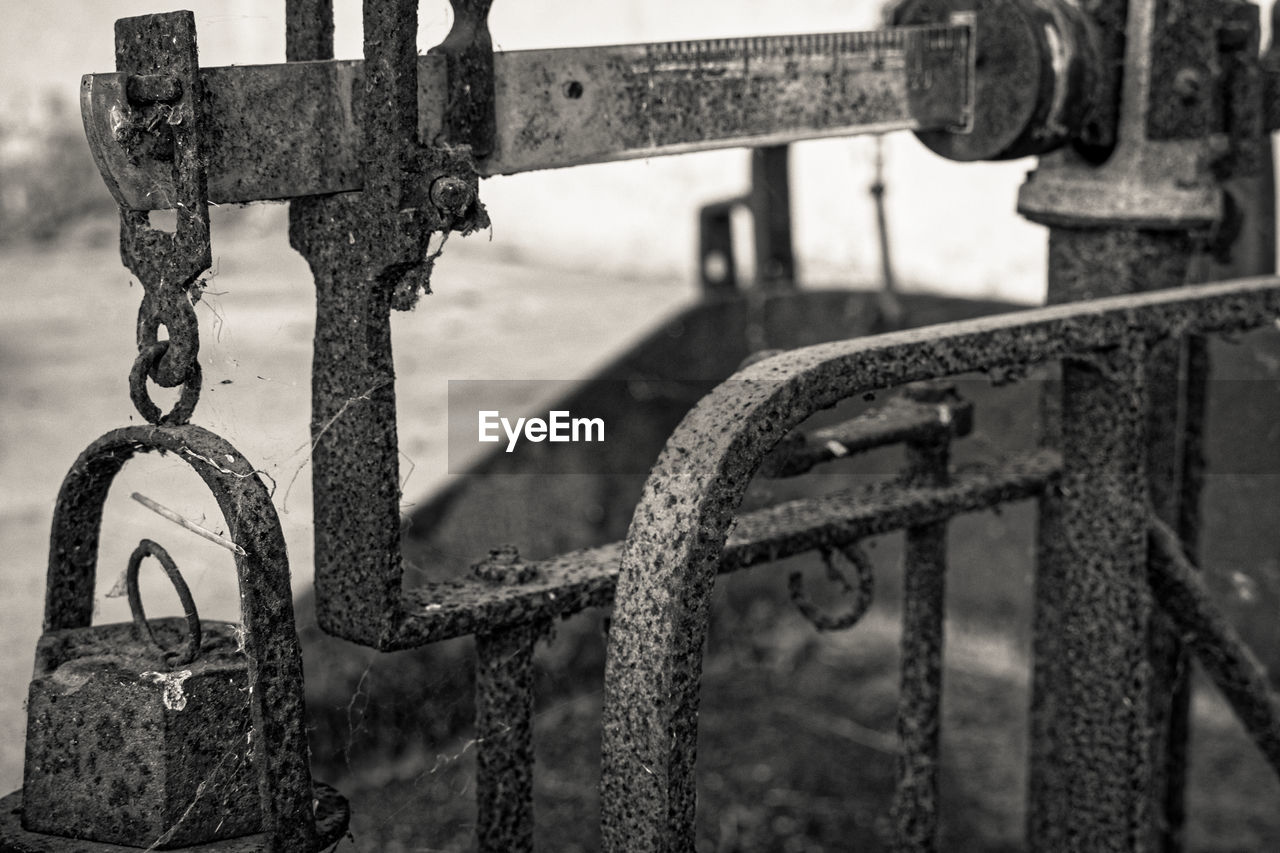 metal, focus on foreground, close-up, no people, chain, day, rusty, boundary, barrier, fence, connection, outdoors, hanging, railing, nature, security, old, transportation, weathered, protection, wheel