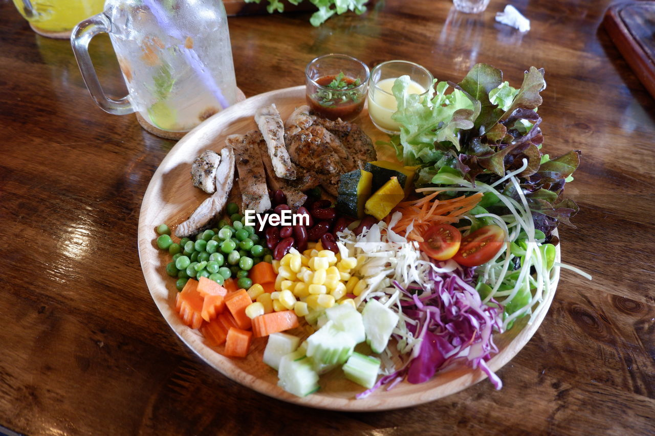 food and drink, food, vegetable, table, healthy eating, ready-to-eat, indoors, freshness, salad, wellbeing, no people, plate, variation, meat, choice, high angle view, meal, still life, wood - material, close-up, dinner, glass, snack