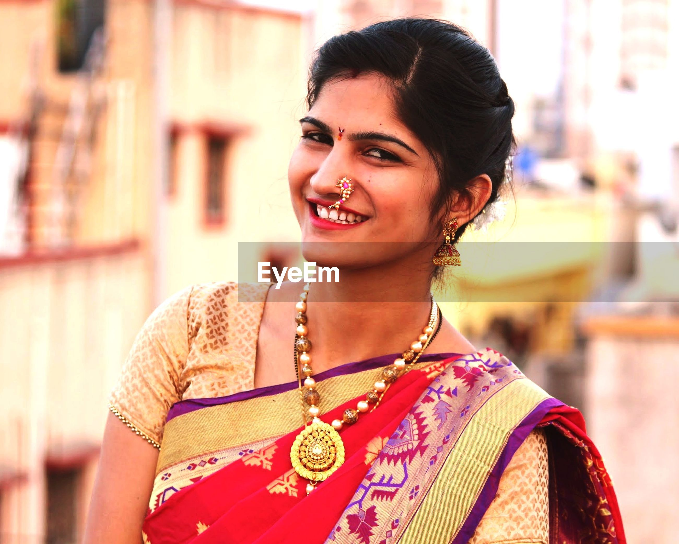 Portrait of smiling young woman wearing sari outdoors