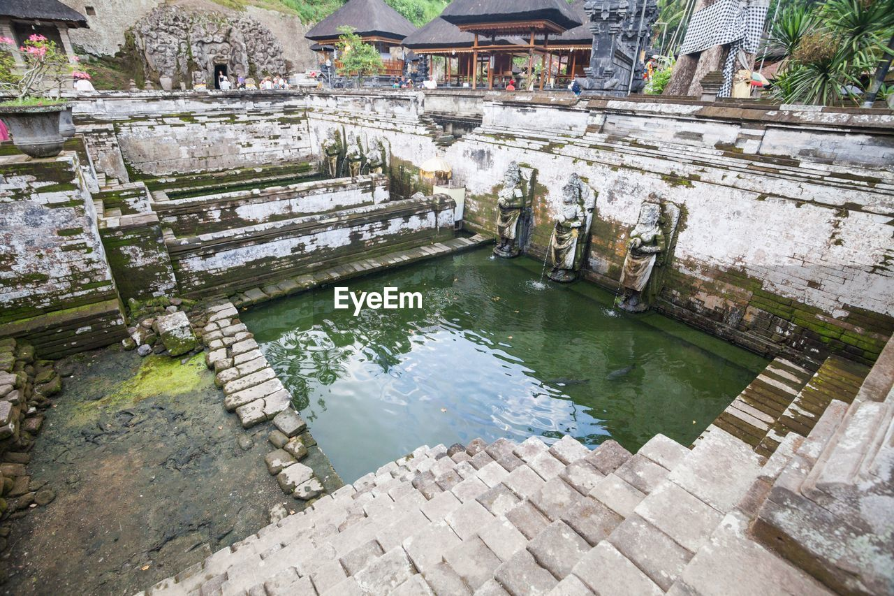water, architecture, building exterior, built structure, outdoors, day, history, high angle view, no people, travel destinations, watermill, nature