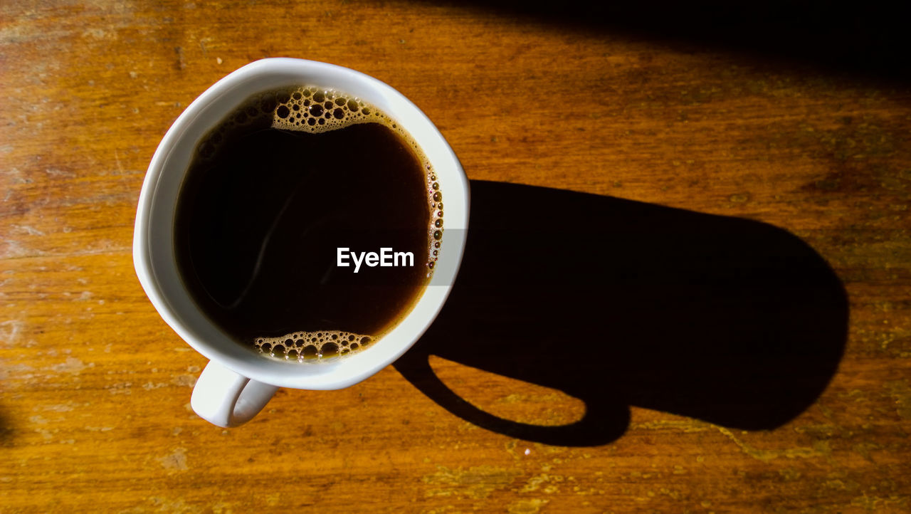 Directly Above View Of Fresh Black Coffee Served On Table