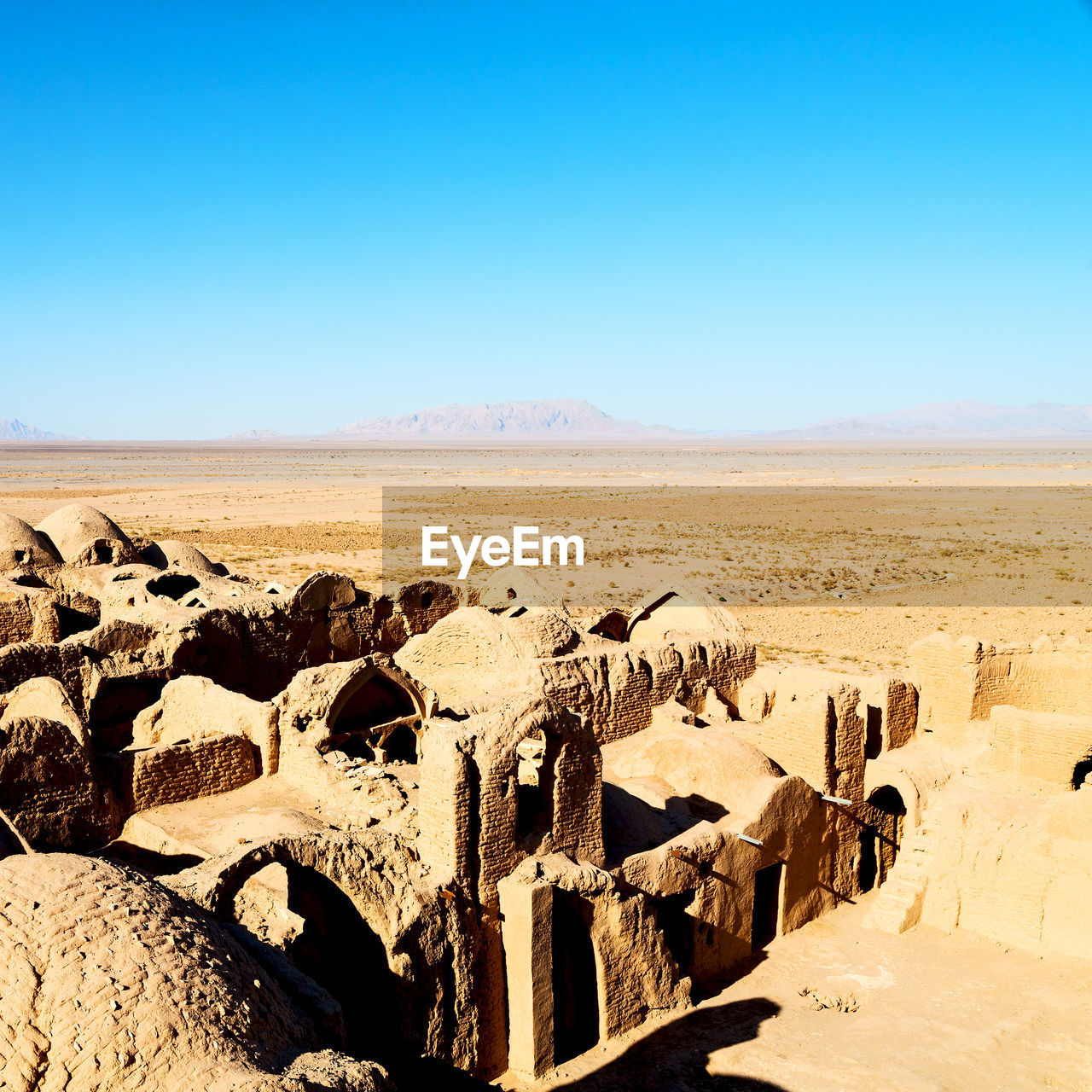 sky, clear sky, copy space, ancient, travel destinations, nature, history, tourism, the past, architecture, blue, travel, day, no people, ancient civilization, sunlight, old ruin, built structure, old, scenics - nature, archaeology, outdoors, climate, ruined, arid climate, deterioration