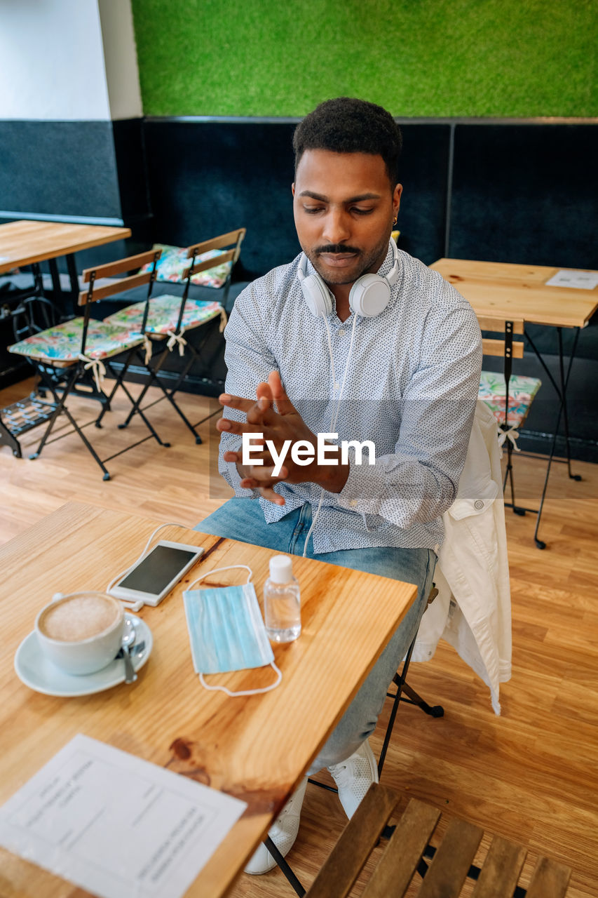 Man sitting on table at cafe