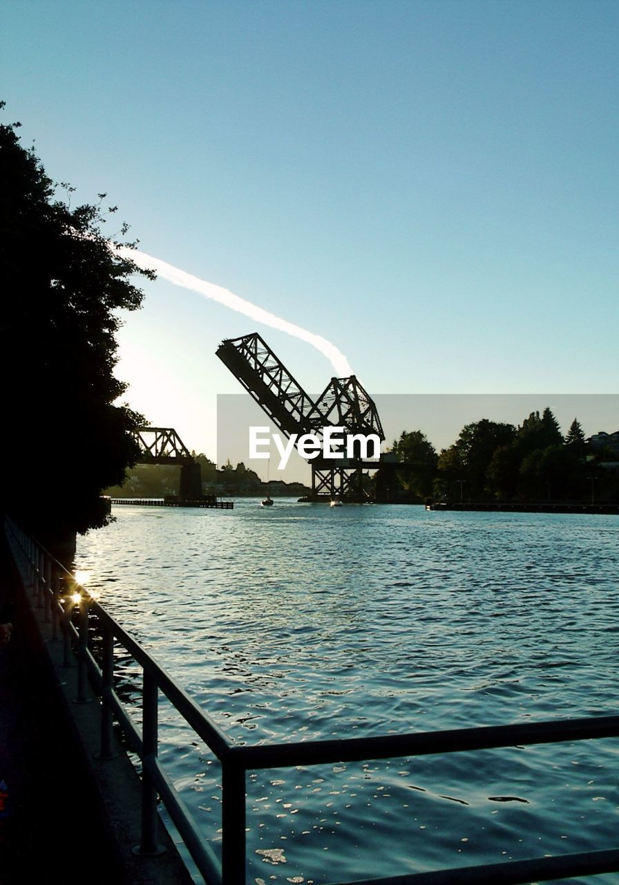 clear sky, water, tree, bridge - man made structure, connection, river, built structure, outdoors, sky, no people, day, nature, architecture