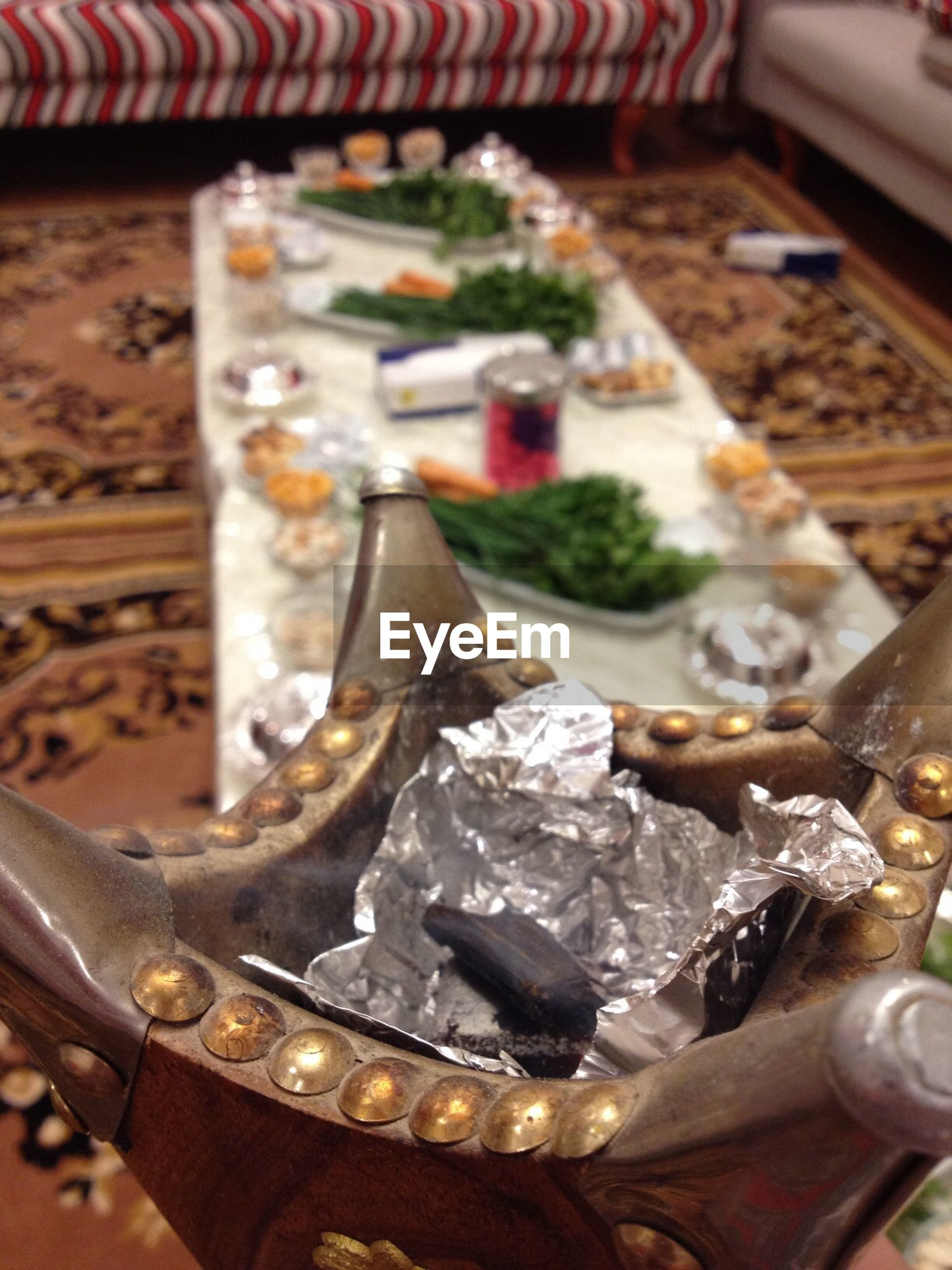 indoors, close-up, still life, metal, focus on foreground, selective focus, no people, high angle view, metallic, table, food and drink, food, day, religion, large group of objects, art and craft, cultures, old, old-fashioned, freshness