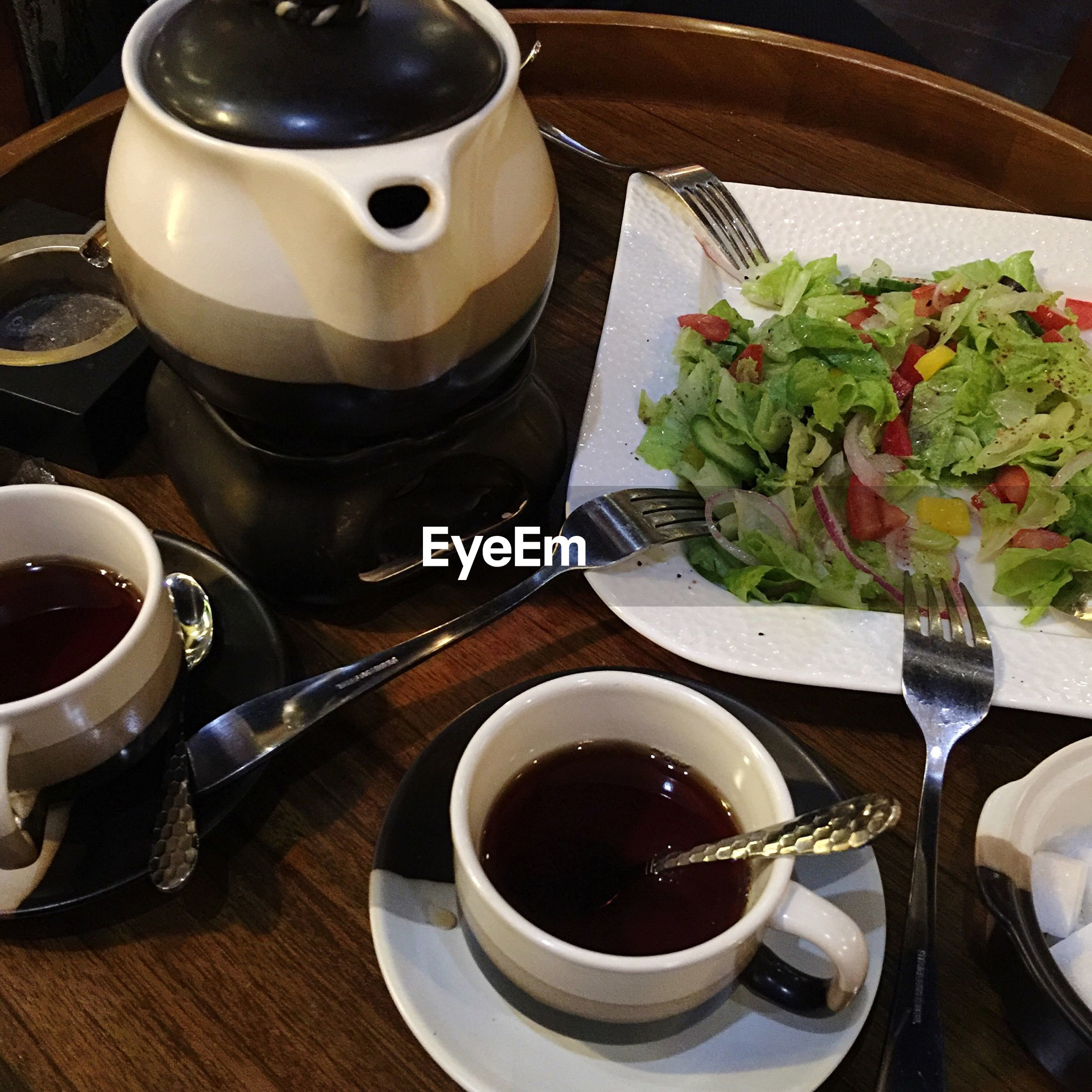 food and drink, table, coffee cup, drink, indoors, freshness, coffee - drink, saucer, refreshment, cup, spoon, coffee, still life, plate, high angle view, tea cup, healthy eating, tea, tea - hot drink, close-up