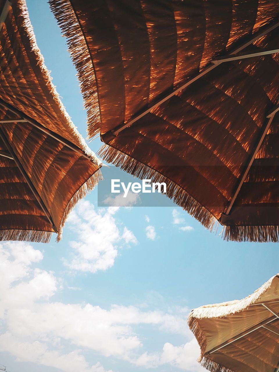 Low Angle View Of Thatched Roof Against Sky