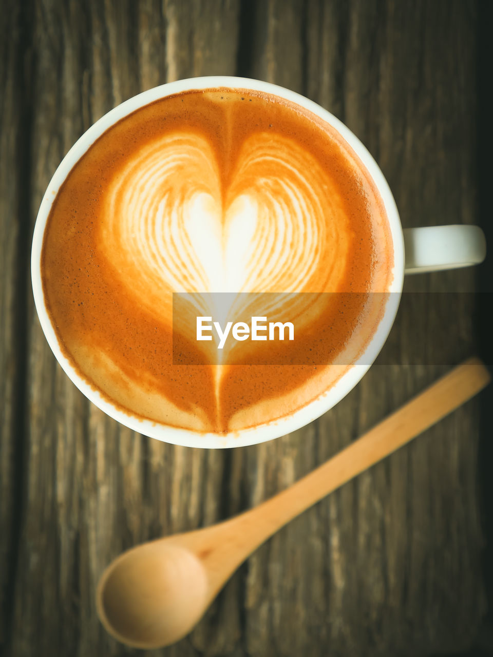 coffee - drink, coffee cup, drink, cappuccino, frothy drink, refreshment, food and drink, froth art, heart shape, latte, freshness, close-up, table, cup, love, directly above, high angle view, saucer, indoors, no people, leaf, day