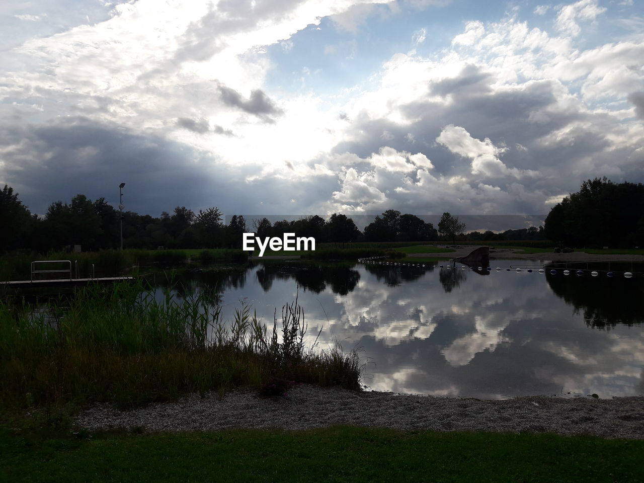 water, reflection, sky, cloud - sky, nature, tranquility, beauty in nature, lake, scenics, tranquil scene, outdoors, tree, no people, grass, landscape, day, power in nature
