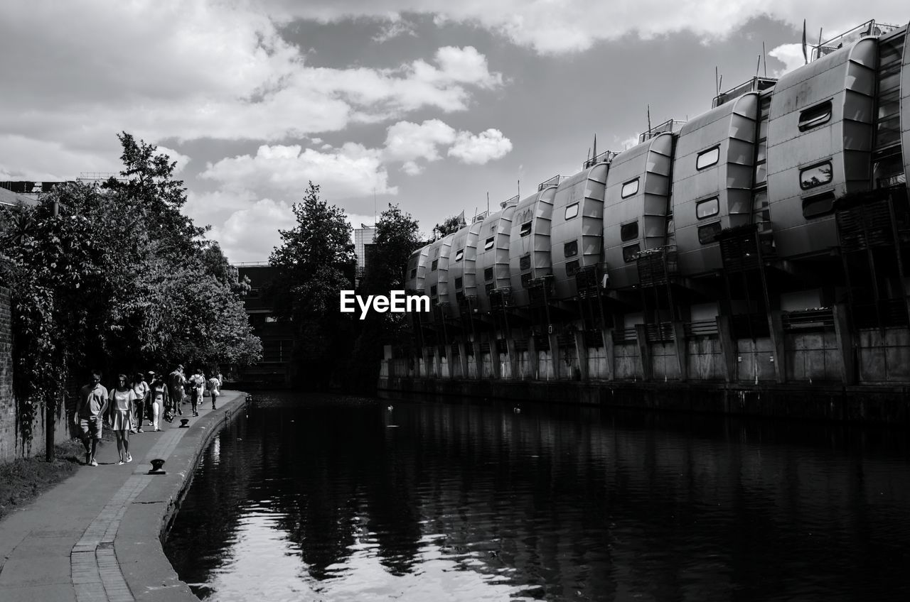 Canal Along Built Structures And Trees