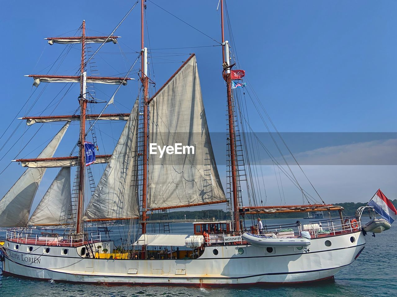 nautical vessel, mode of transportation, transportation, sailboat, water, sky, mast, pole, sea, sailing, ship, day, nature, moored, travel, sailing ship, outdoors, no people, rope, rigging, yacht