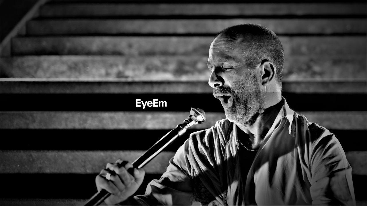 Close-Up Of Mature Man Singing